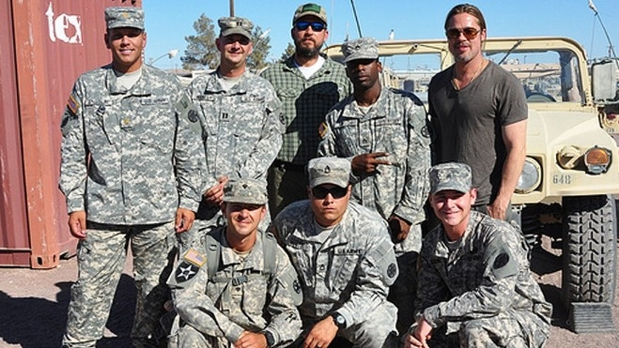 FORT IRWIN, Calif. Actors Brad Pitt, Shia LaBeouf, Logan Lerman, Jon Bernthal, Kevin Vance, director David Ayer, set coordinator Owen Thornton and co-producer Alex Ott from the movie, 'Fury,' visited the National Training Center, June 26–28.