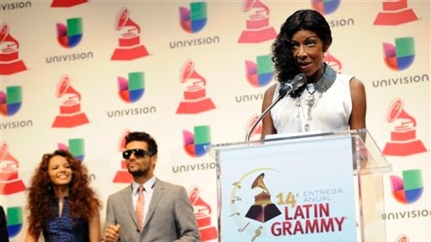 Singer Natalie Cole announces Latin Grammy nominations as fellow musicians Leslie Grace and Draco Rosa look on, Wednesday, Sept. 25, 2013 in Los Angeles.