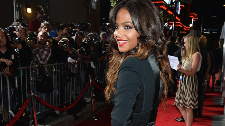 "LOS ANGELES, CA - SEPTEMBER 25:  Actress Christina Milian attends the premiere of Fox Searchlight Pictures' ""Baggage Claim"" at Regal Cinemas L.A. Live on September 25, 2013 in Los Angeles, California.  (Photo by Alberto E. Rodriguez/Getty Images)"