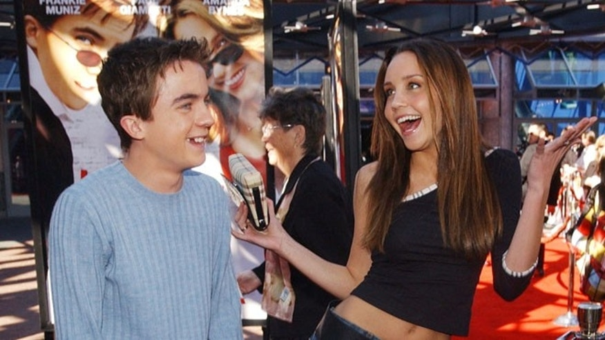 "Feb. 2, 2002: Actors Frankie Muniz (L) and Amanda Bynes, cast members in the motion picture comedy ""Big Fat Liar,"" ham it up at the premiere of the film at Universal Studios Cinema in Los Angeles, California."