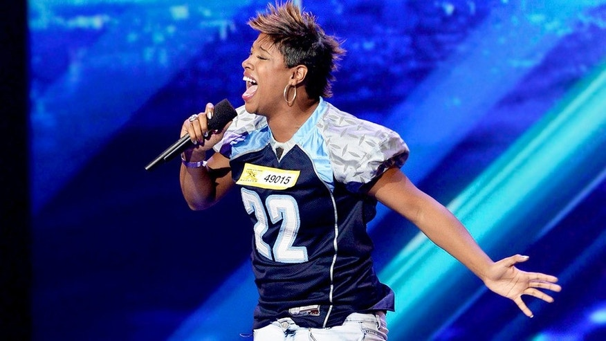 "Professional women's football player Lorie Moore wowed the ""X Factor"" judges with her performance of Whitney Houston's ""I Have Nothing."""