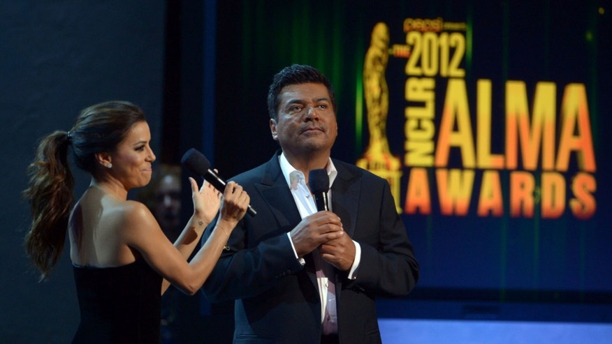 PASADENA, CA - SEPTEMBER 16:  Hosts Eva Longoria and George Lopez speak onstage at the 2012 NCLR ALMA Awards at Pasadena Civic Auditorium on September 16, 2012 in Pasadena, California.  (Photo by Kevin Winter/Getty Images for NCLR)