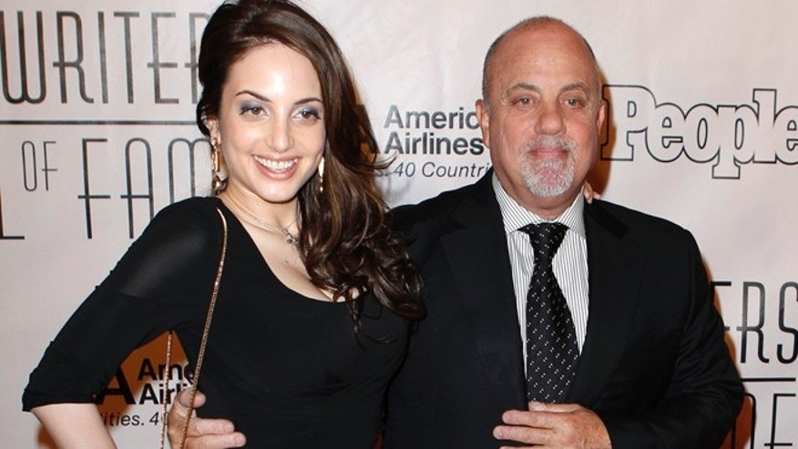 Singer Billy Joel arrives with his daughter Alexa Ray Joel for the Songwriters Hall of Fame awards in New York June 16, 2011.  REUTERS/Lucas Jackson (UNITED STATES - Tags: ENTERTAINMENT) - RTR2NR82