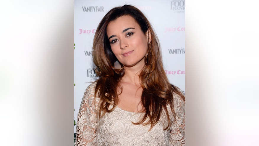 Actress Cote de Pablo attends the Vanity Fair and Juicy Couture celebration for the Vanities Calendar at the Chateau Marmont in West Hollywood, California February 18, 2013.