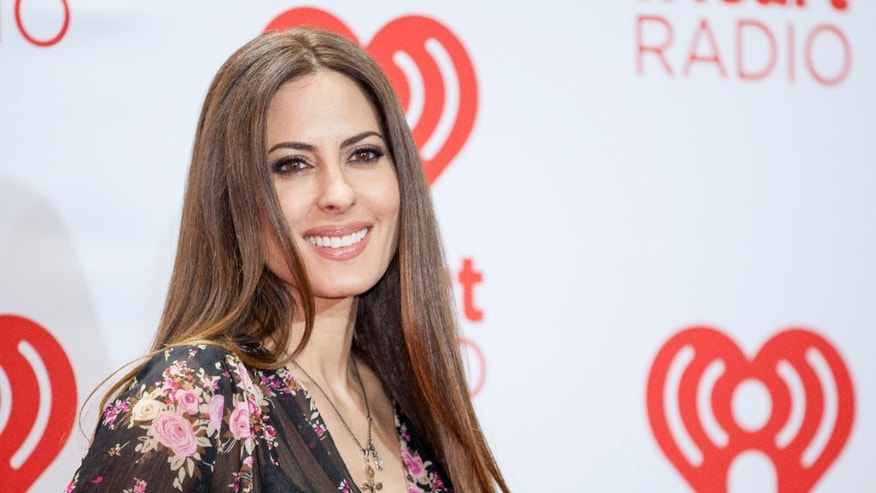 Casey Kasem's daughter Kerri Kasem arrives at the iHeartRadio Music Festival, Saturday Sept. 21st, 2013, at the MGM Grand Garden Arena in Las Vegas.