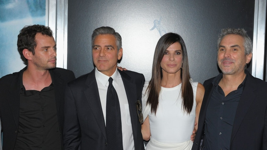 "Jonas Cuaron, George Clooney, Sandra Bullock and Alfonso Cuaron attend the ""Gravity"" premiere on October 1, 2013 in New York City."