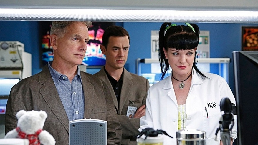"Colin Hanks, center, Mark Harmon, left, and the ""NCIS"" team appear on the 11th season premiere of ""NCIS"" on the CBS Television Network."