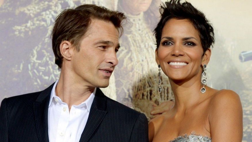 "LOS ANGELES, CA - OCTOBER 24:  Actress Halle Berry (R) and actor Olivier Martinez arrive at the premiere of Warner Bros. Pictures' ""Cloud Atlas"" at the Chinese Theatre on October 24, 2012 in Los Angeles, California.  (Photo by Kevin Winter/Getty Images)"