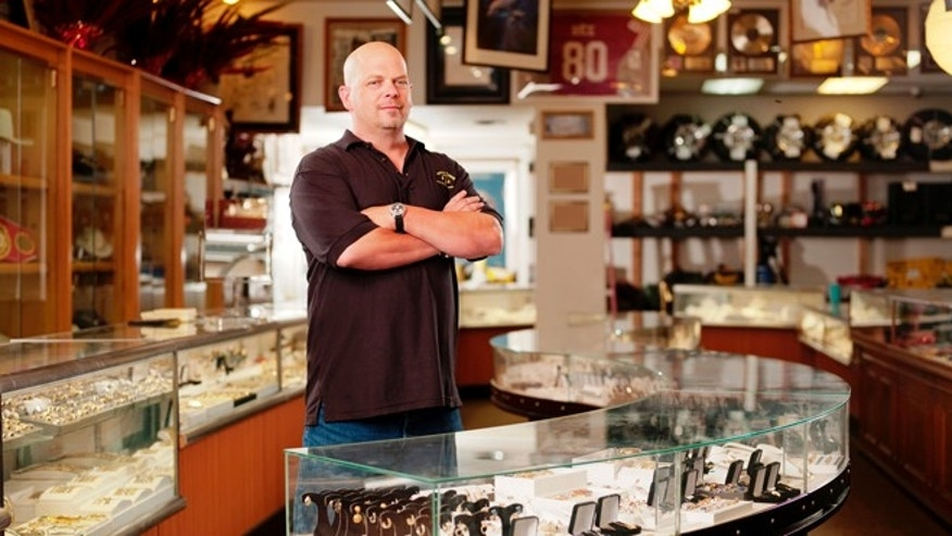 """Pawn Stars"" cast member Rick Harrison poses in Gold and Silver Pawn."