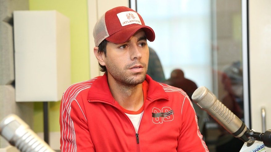 "Enrique Iglesias visits ""The Elvis Duran Z100 Morning Show"" at Z100 Studio on July 18, 2013 in New York City."
