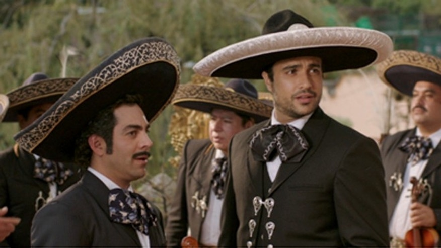 """Omar Chaparro, left, and Jaime Camil in the film """"Pulling Strings"""" by Pantelion Films."""
