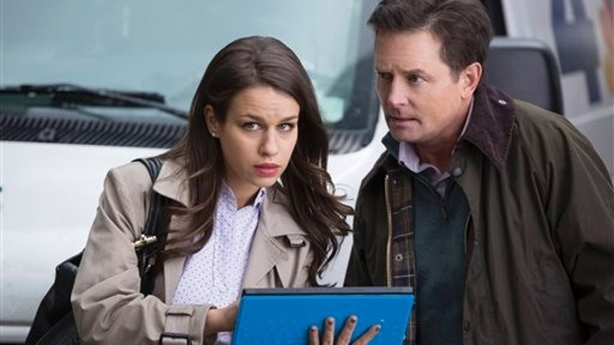 "This image released by NBC shows Ana Nogueira as Kay, left, and Michael J. Fox as Mike Henry in ""The Michael J. Fox Show,"" premiering Sept. 26. (AP Photo/NBC, Eric Liebowitz)"