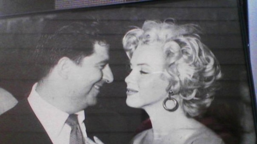 Monroe with Lionel Newman at a Hollywood function.