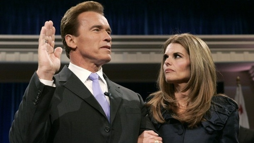 Jan. 2007: Arnold Schwarzenegger is sworn in for a second term with his now-estranged wife Maria Shriver. (Reuters)