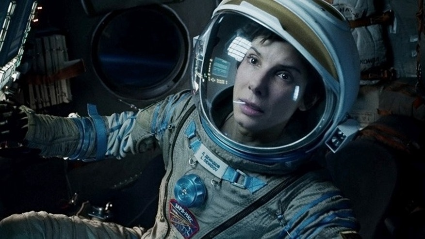 "This film image released by Warner Bros. Pictures shows Sandra Bullock in a scene from ""Gravity."" Topping the box office for the third straight week, the space adventure Gravity continues to be the box-office juggernaut of the fall. The film, starring Sandra Bullock, earned $31 million over the weekend, according to studio estimates Sunday, Oct. 20, 2013."