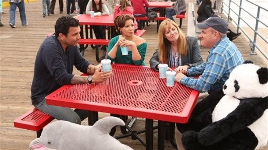 "Ricardo Chavira, Justina Machado, Mary McCormack and Mike O'Malley in ""Welcome to the Family."""
