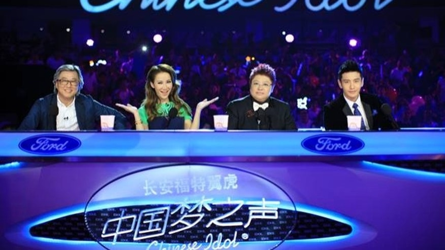 "The judges of ""Chinese Idol"" are shown in a promotional photo."