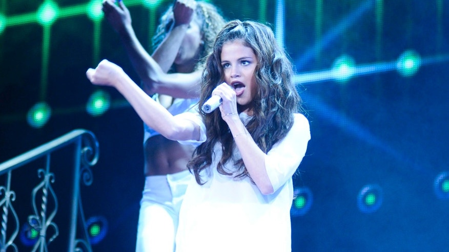 Selena Gomez performs at the Patriot Center on October 10, 2013 in Washington, DC.
