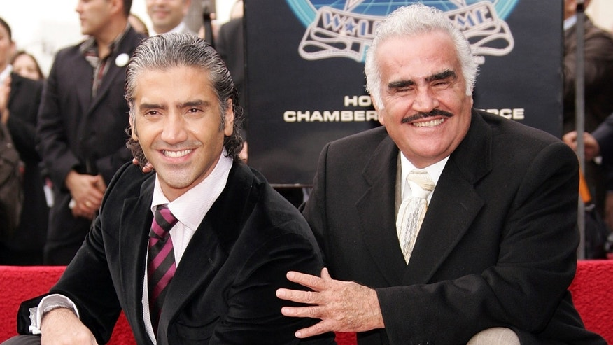 LOS ANGELES - DECEMBER 02:  Ranchera singer Vicente Fernandez (R) poses with his son Alejandro Fernandez, who is honored with a Star On The Walk Of Fame, on December 2, 2005 in Los Angeles, Califoria.  (Photo by Frazer Harrison/Getty Images)