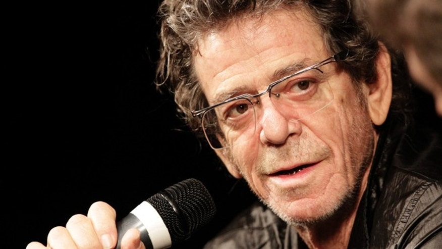 "April 20, 2010: American singer Lou Reed smiles during a session after the world premiere of his first film ""Red Shirley"" at the Vision du Reel Documentary film Festival in Nyon, Switzerland. The film is about an interview Reed conducts with his cousin on the eve of her hundredth birthday."