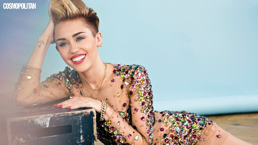 Miley Cyrus appears in the December 2013 issue of Cosmopolitan.