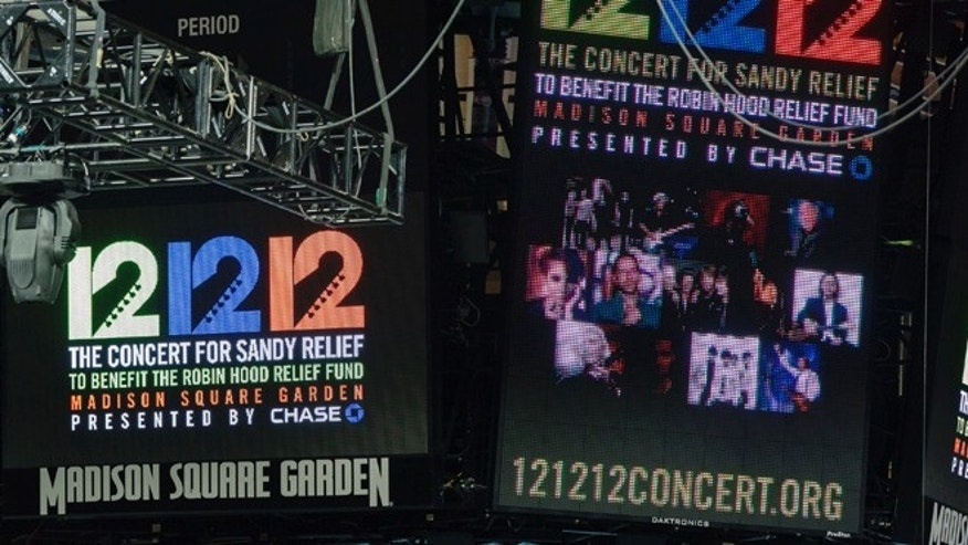Signs are lit on the scoreboard for the 12-12-12 fundraising concert at Madison Square Garden to raise funds for victims of Hurricane Sandy in New York, December 11, 2012.   REUTERS/Lucas Jackson (UNITED STATES - Tags: ENTERTAINMENT) - RTR3BGJL