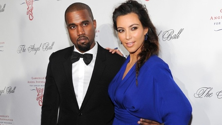 Oct. 22, 2012: In this file photo, singer Kanye West, left, and girlfriend Kim Kardashian attend Gabrielle's Angel Foundation 2012 Angel Ball cancer research benefit at Cipriani Wall Street in New York.