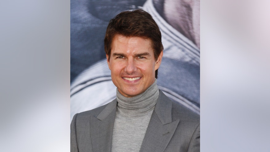 "FILE - In this April 13, 2013 file photo, Tom Cruise arrives at the LA premiere of ""Oblivion"" at the TCL Chinese Theater in Los Angeles.  Cruise wrote in a sworn declaration filed Tuesday, Nov. 5, 2013, in a defamation lawsuit against Bauer Publishing Co. that he maintains a close relationship with his daughter Suri despite the claims by two Bauer tabloids in 2012 that he had ""abandoned"" her.(Photo by Todd Williamson /Invision/AP, File)"