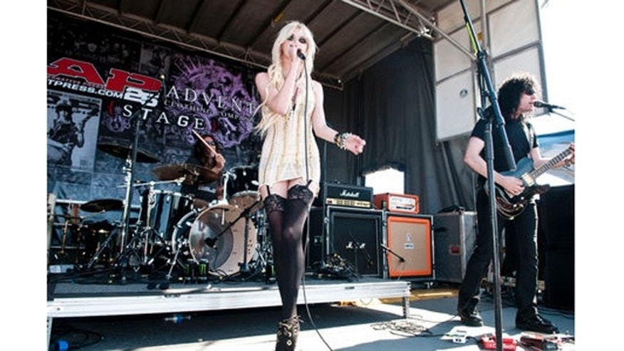 Taylor Momsen of The Pretty Reckless performs as part of the Vans Warped Tour 2010 at Shoreline Amphitheatre on June 26, 2010 in Mountain View, California. She seems to have a tampon string hanging from her panties.  June 26, 2010 X17online.com exclusive