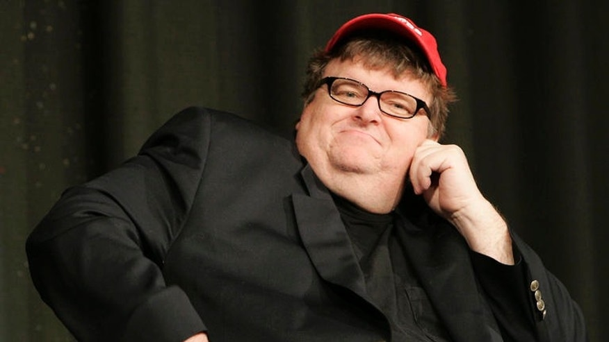 Filmmaker Michael Moore's proposal to release crime scene photographs from Sandy Hook Elementary School would be a 'horrendous offense' to relatives of victims, Dorrie Carolan, co-president of the Newtown Parent Connection, Inc., told FoxNews.com. (AP)