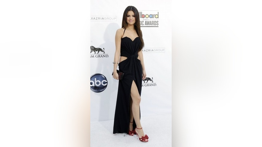 Singer Selena Gomez arrives at the 2011 Billboard Music Awards show in Las Vegas May 22, 2011. REUTERS/Steve Marcus (UNITED STATES - Tags: ENTERTAINMENT)