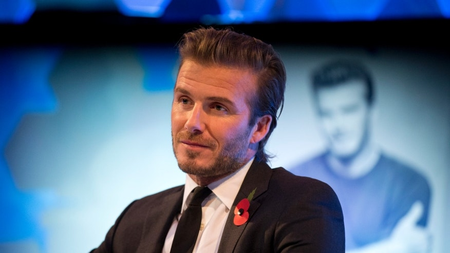 "Former England national soccer team captain David Beckham listens to a question as he is interviewed by The Associated Press at a studio in Hampstead, north London, Wednesday, Oct. 30, 2013.  Beckham was promoting his new photography book entitled ""David Beckham"".  (AP Photo/Matt Dunham)"