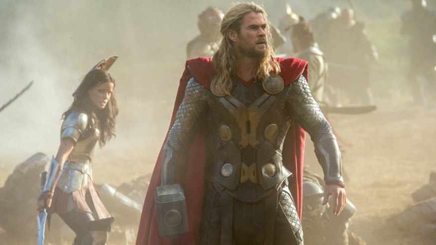 "This publicity photo released by Walt Disney Studios and Marvel shows Jaimie Alexander, left, and Chris Hemsworth in a scene from ""Thor: The Dark World."""