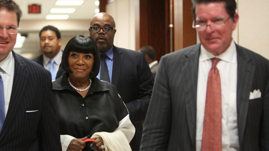 Singer Patti LaBelle walks out of the courtroom after testifying on the witness stand at the Harris County Criminal Courthouse for the lawsuit against her bodyguards on Thursday, Nov. 7, 2013, in Houston. LaBelle told a Houston court Thursday that Richard King scared her in 2011 when he staggered toward her limousine at George Bush Intercontinental Airport. LaBelle's bodyguard, Efrem Holmes, is charged with misdemeanor assault in the clash caught on security video that landed King in a hospital with a head wound. Records show King's blood alcohol level was more than three times the legal limit for driving. King testified Thursday that he could not remember details of the incident. King has also filed a civil lawsuit against the singer and Holmes. LaBelle has countersued.(AP Photo/Houston Chronicle, Mayra Beltran)