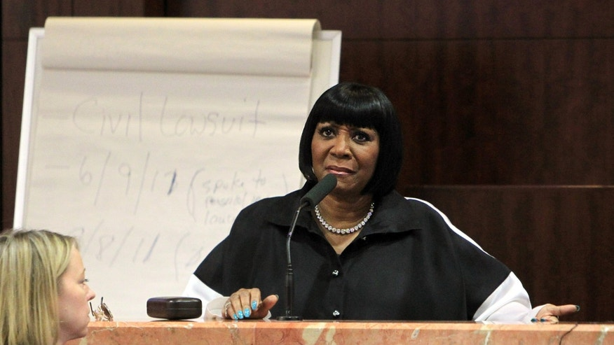 Singer Patti LaBelle  testifies on the witness stand  at the Harris County Criminal Courthouse for the lawsuit against her bodyguards on Thursday, Nov. 7, 2013, in Houston. LaBelle told a Houston court Thursday that Richard King scared her in 2011 when he staggered toward her limousine at George Bush Intercontinental Airport. LaBelle's bodyguard, Efrem Holmes, is charged with misdemeanor assault in the clash caught on security video that landed King in a hospital with a head wound. Records show King's blood alcohol level was more than three times the legal limit for driving. King testified Thursday that he could not remember details of the incident. King has also filed a civil lawsuit against the singer and Holmes. LaBelle has countersued.(AP Photo/Houston Chronicle, Mayra Beltran)