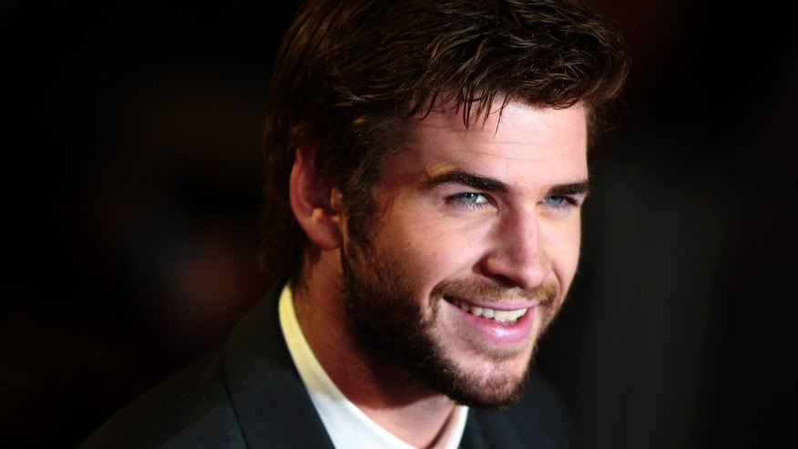 "Actor Liam Hemsworth arrives for the world premiere of ""The Hunger Games : Catching Fire"" at Leicester Square in London November 11, 2013. REUTERS/Luke MacGregor (BRITAIN - Tags: ENTERTAINMENT SOCIETY) - RTX159PF"