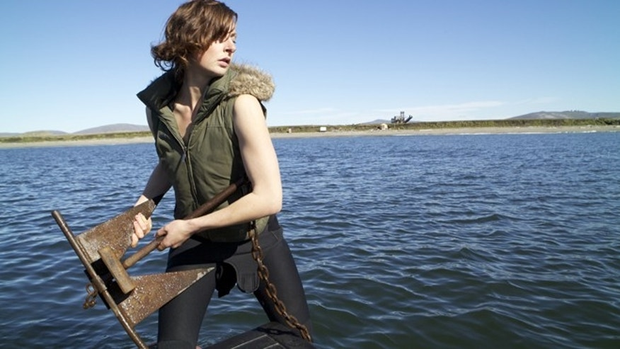 "Emily Riedel  hoists The Clarks anchor on ""Bering Sea Gold."""