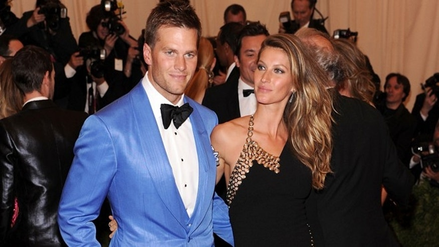 """NEW YORK, NY - MAY 06:  NFL player Tom Brady (L) and model Gisele Bundchen attend the Costume Institute Gala for the """"PUNK: Chaos to Couture"""" exhibition at the Metropolitan Museum of Art on May 6, 2013 in New York City.  (Photo by Jamie McCarthy/Getty Images for The Huffington Post)"""