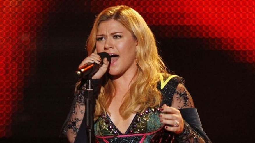 FILE: Dec.16, 2012: Kelly Clarkson performs during the VH1 Divas show in Los Angeles.