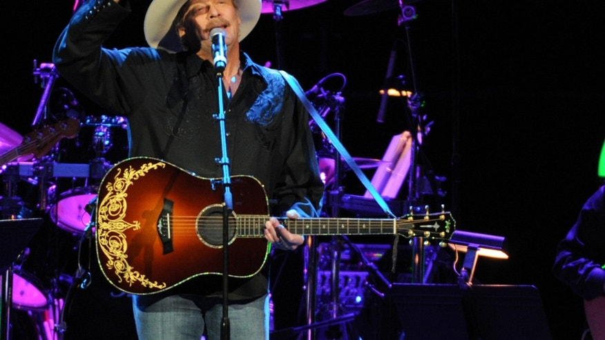 November 22, 2013. Alan Jackson performs at the George Jones Tribute - Playin' Possum: The Final No Show at the Bridgestone Arena in Nashville, Tenn.