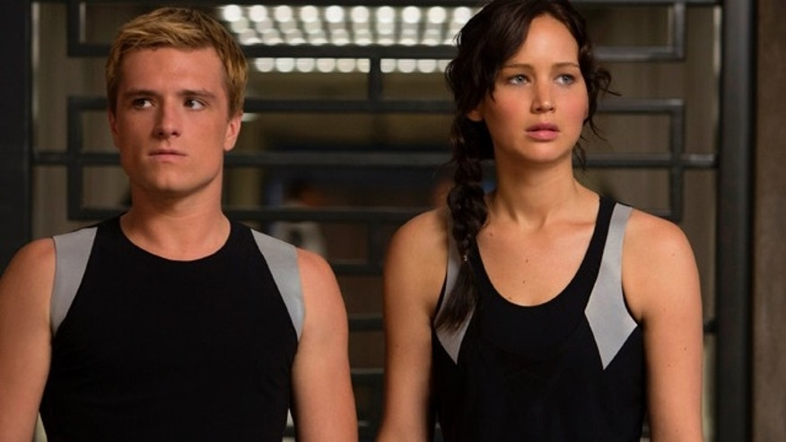 "This image released by Lionsgate shows Josh Hutcherson as Peeta Mellark, left, and Jennifer Lawrence as Katniss Everdeen in a scene from ""The Hunger Games: Catching Fire."""