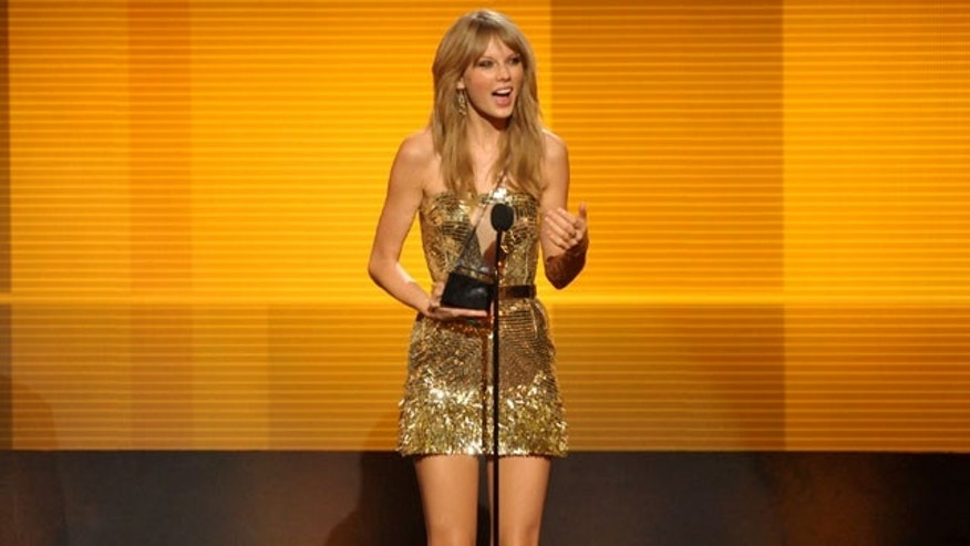 November 24, 2013: Taylor Swift accepts the award for favorite female artist - country at the American Music Awards at the Nokia Theatre in Los Angeles. (Photo by John Shearer/Invision/AP)