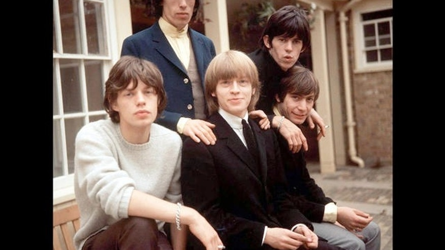 ** FILE ** The Rolling Stones, left to right: Mick Jagger, Bill Wyman, Brian Jones,  Keith Richards and Charlie Watts are seen in this Sept. 12, 1964 file photo. Rolling Stones drummer Charlie Watts is being treated for throat cancer, a spokesman for the band said Saturday Aug. 14 2004. Watts, 63, was mid-way through a course of radiotherapy at the Royal Marsden Hospital in Chelsea, south west London, near his home, he said. The musician, whose records with the Stones have sold millions around the world, was diagnosed after going into the hospital in June. (AP Photo/PA) ** UNITED KINGDOM OUT  NO SALES  MAGS OUT **