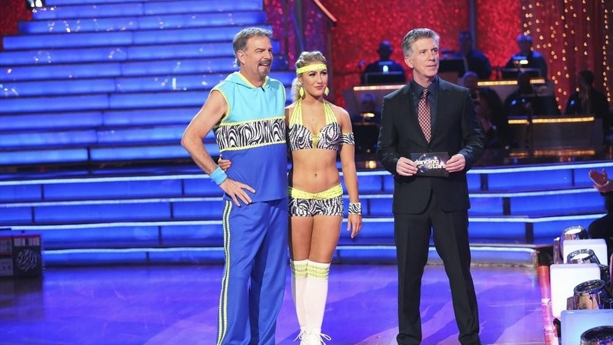 "Bill Engvall and Emma Slater appear alongside host Tom Bergeron on ""Dancing with the Star."""