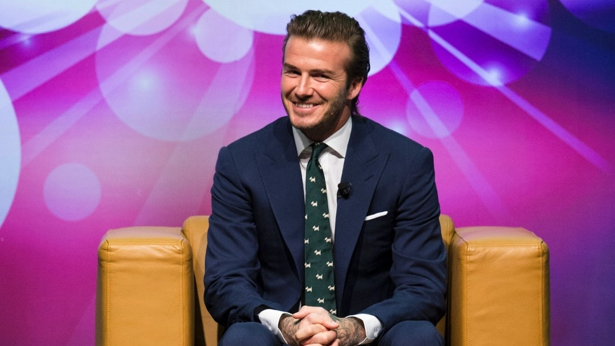 November 22, 2013. Former England soccer team captain David Beckham attends a promotional event at the Venetian Macao hotel in Macau.