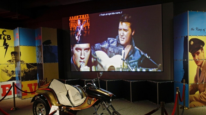 In this Nov. 25, 2013 photo, a custom motorcycle is displayed in the Elvis exhibit at the Rock and Roll Hall of Fame and Museum in Cleveland. Over 40 new items on loan from Graceland, excluding the cycle, will be displayed when the exhibit reopens.