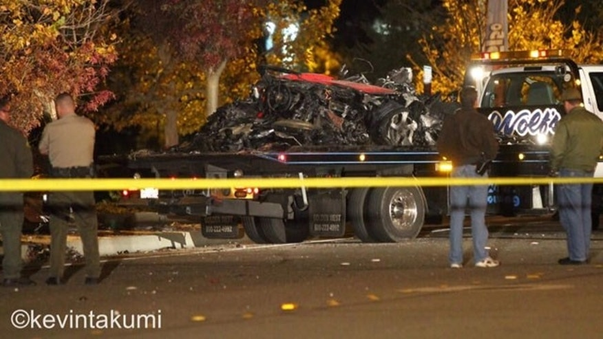 November 30, 2013: A flatbed truck hauls away what remains of the Porsche in which actor Paul Walker was a passenger when it crashed Saturday afternoon, killing Walker and the unidentified driver of the car (Courtesy Kevin Takumi)