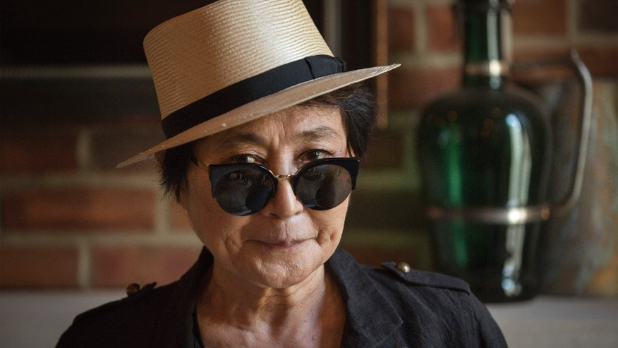"July 2, 2013. Yoko Ono poses for a photograph while promoting her new book ""Acorn"" during a book signing in New York."