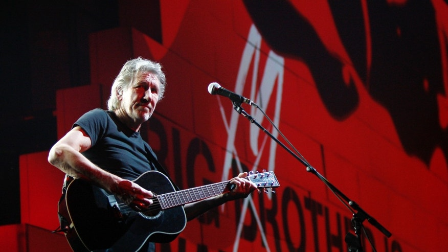 "FILE - In this April 1, 2011 file photo, Roger Waters performs during his ""The Wall Tour 2010/2011"" in Milan, Italy. Now that his three-year world tour for ""The Wall"" has finally come to an end, Waters wants to set the record straight over criticism he's received from Jewish groups regarding his use of the Star of David symbol in the show and his support for a cultural boycott of Israel. (AP Photo/Antonio Calanni, File)"