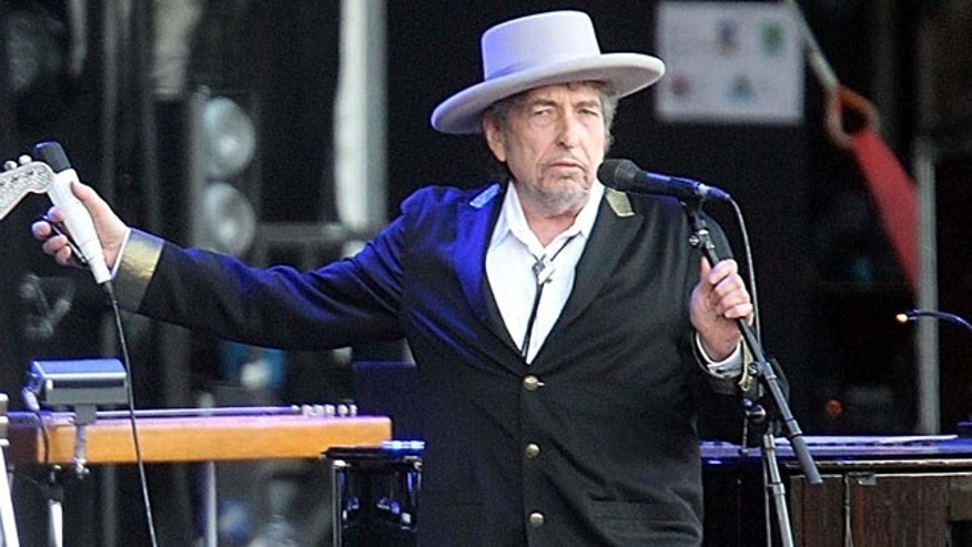 "FILE - This July 22, 2012 file photo shows U.S. singer-songwriter Bob Dylan performing on at ""Les Vieilles Charrues"" Festival in Carhaix, western France. (AP Photo)"